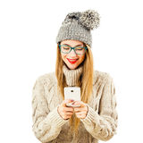 Smiling Winter Hipster Girl in with Mobile Phone on White Royalty Free Stock Photo