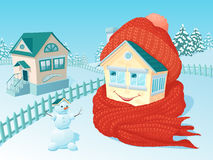 Smiling winter house wrapped up in a warm knitted scarf and a cap. The small one-storey lodge in winter rural areas which is wrapped up in a warm knitted scarf Royalty Free Stock Photos