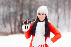 Smiling Winter Woman with Binoculars looking for Christmas Stock Images
