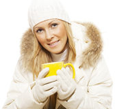 Smiling winter woman holding hot tea Royalty Free Stock Photography