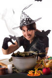 Smiling witch making magic on Halloween Stock Photos
