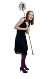 Smiling witch managing house work Stock Images