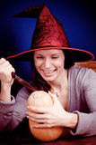 Smiling witch with pumpkin Stock Photo