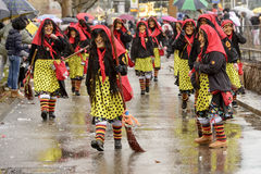 Smiling witches under rain at Carnival parade, Stuttgart royalty free stock photography
