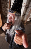 Smiling Wizard Pointing Royalty Free Stock Image