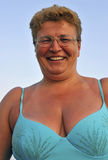 Smiling woman. Portrait of a smiling woman in swim-suit at the beach Stock Image