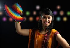 Smiling woman. With colorful hat Stock Images