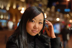 Smiling woman. Smiling asian woman at night outdoors royalty free stock image
