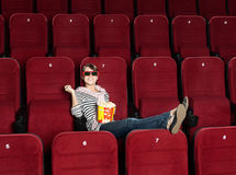 Smiling woman in 3D movie theater Stock Photo