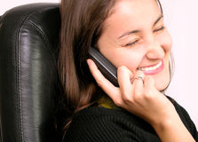 Smiling woman. Happy woman, laughing and speaking at the phone royalty free stock photography