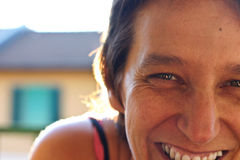 Smiling woman. A close-up of a smiling happy woman royalty free stock photo