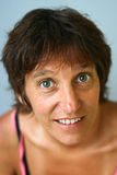 Smiling woman. A smiling middle-aged woman with green eyes royalty free stock photos
