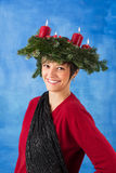 Smiling woman with advent wreath Royalty Free Stock Image