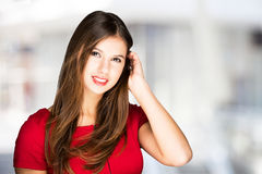 Smiling woman against a bright background Stock Image