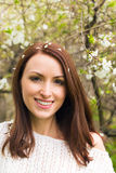 Smiling woman against spring trees Royalty Free Stock Photography