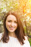Smiling woman against spring trees Royalty Free Stock Images