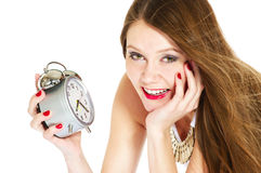 Smiling woman with alarm-clock Royalty Free Stock Photo