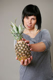 Smiling woman with ananas Royalty Free Stock Photo