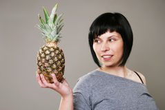 Smiling woman with ananas Royalty Free Stock Image