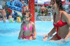 Smiling Woman And Little Girl Bathes In Pool Stock Photography