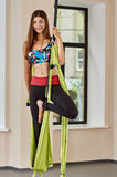 Smiling woman anti-gravity aerial yoga portrait Royalty Free Stock Images