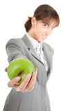 Smiling woman with apple. Smiling woman in business clothing with apple Royalty Free Stock Image