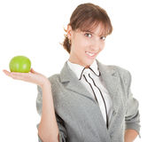 Smiling woman with apple. Smiling woman in business clothing with apple Royalty Free Stock Photos