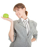 Smiling woman with apple. Smiling woman in business clothing with apple Stock Photo