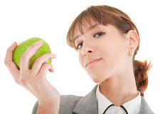 Smiling woman with apple Stock Images