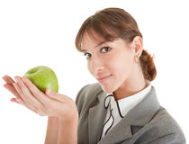 Smiling woman with apple. Smiling woman in business clothing with apple Royalty Free Stock Images