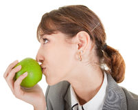 Smiling woman with apple. Smiling woman in business clothing with apple Stock Images