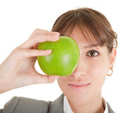 Smiling woman with apple. Smiling woman in business clothing with apple Royalty Free Stock Photo