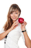 Smiling woman with apple. In white suite Stock Images