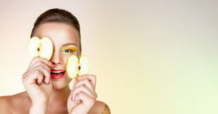 Smiling woman with an apple. Smiling happy woman with  an apple Royalty Free Stock Images