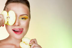 Smiling woman with an apple. Smiling happy woman with  an apple Stock Photos