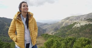 Smiling woman appreciating the peace of nature stock video footage