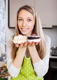 Smiling woman in apron with cakes Stock Photography