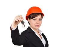 Smiling woman architect with key Stock Photo