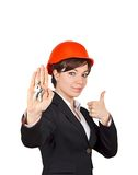 Smiling woman architect with key Royalty Free Stock Photography