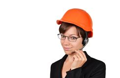 Smiling woman architect talking on headset Stock Photos