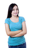 Smiling woman with arms folded - isolated Royalty Free Stock Photos