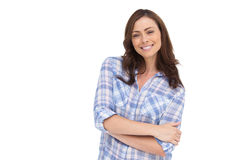 Smiling woman with arms folded Stock Images