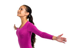 Smiling woman with arms outstretched looking up Royalty Free Stock Image
