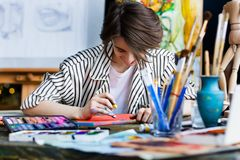 Young student artist at art workplace royalty free stock photo