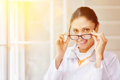 Smiling woman as doctor stock photography