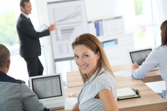 Smiling woman attending business presentation Stock Photos
