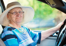 Smiling woman in auto Stock Image