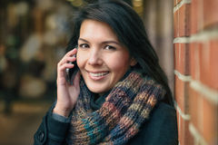 Smiling Woman in Autumn Fashion Talking on Phone Stock Image