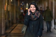 Smiling Woman in Autumn Fashion Talking on Phone Royalty Free Stock Photography