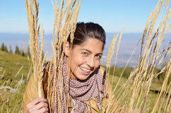 Smiling woman in the autumn mountain Stock Photos